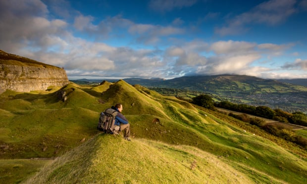 Hiker in the Llangattock escarpment in Brecon Beacons
