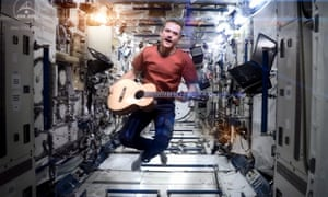 Canadian Space Agency astronaut Chris Hadfield performing aboard the International Space Station a revised version of David Bowie's song Space Oddity, 12 May 2013. As reported by CSA, Hadfield, for his last downlink before returning to Earth, CSA Astronaut Chris Hadfield performed I.S.S. (Is Somebody Singing) with hundreds of students at the Ontario Science Centre and nearly a million people, mostly students from coast-to-coast Canada and around the world, performing the song in unison from their location. US astronaut Thomas Marshburn and Canadian astronaut Chris Hadfield are due to return back to Earth later on 13 May 2013. EPA/NASA / CSA / CHRIS HADFIELD / HANDOUT HANDOUT EDITORIAL USE ONLY plog