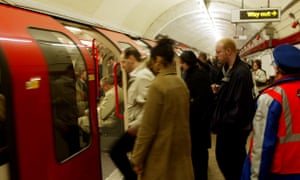 Commuters board a tube train at Chancery Lane on the Central line