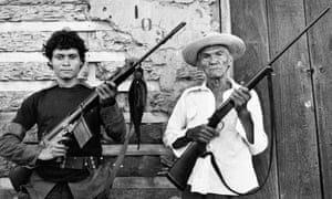 An 87-year-old veteran of the first Sandino rebellion stands with an 18-year-old Sandinista guerrilla in Nicaragua, June 19, 1979.
