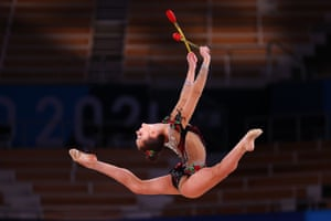 Arina Averina of the Russian Olympic Committee in action with clubs.