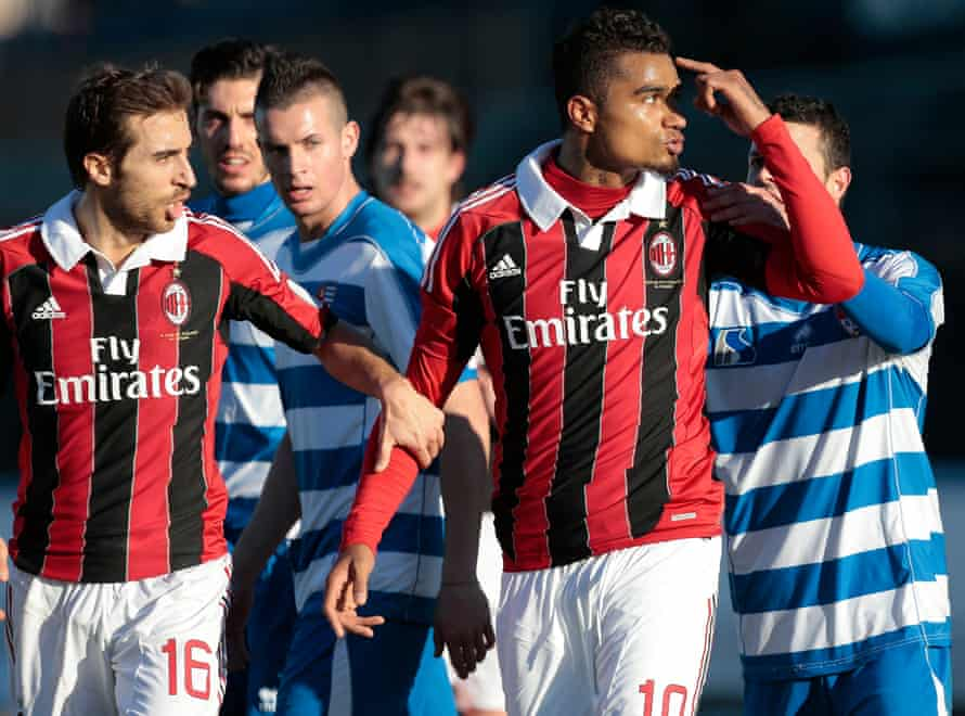 Boateng gestures towards the crowd after racist chants directed at Milan's black players from Pro Patria fans
