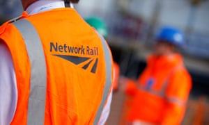 A worker wearing a Network Rail jacket