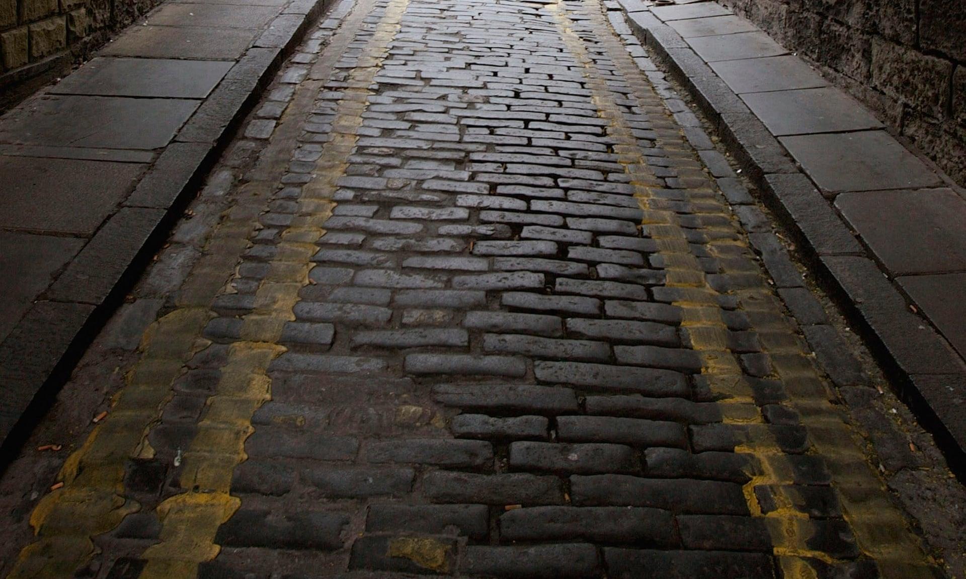 Adoquines cerca de la Royal Mile en Edimburgo. Fotografía: Jeff J Mitchell / Getty Images