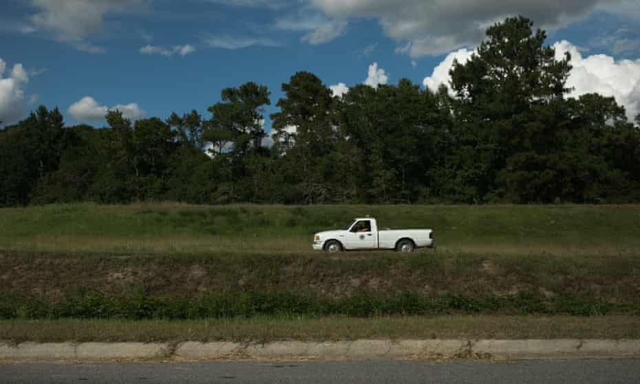 A county worker drives astride the levee along Lowery Street in Lumberton, North Carolina, ahead of Hurricane Florence.