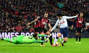 Son Heung-Min rounds Bournemouth keeper Asmir Begovic before slotting the ball into the net for Spurs' fifth goal of the game.