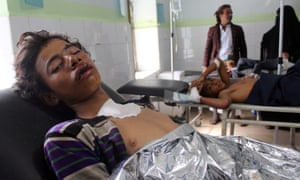 Patients are treated at a hospital in Hajjah in Yemen after an airstrike hit wedding party.