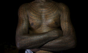 """Mahettar Ram Tandon, 76, a follower of Ramnami Samaj, who has tattooed the name of the Hindu god Ram on his full body.<br><br><em>""""The young generation just don't feel good about having tattoos on their whole body,""""</em> he added. <em>""""That doesn't mean they don't follow the faith.""""</em>"""