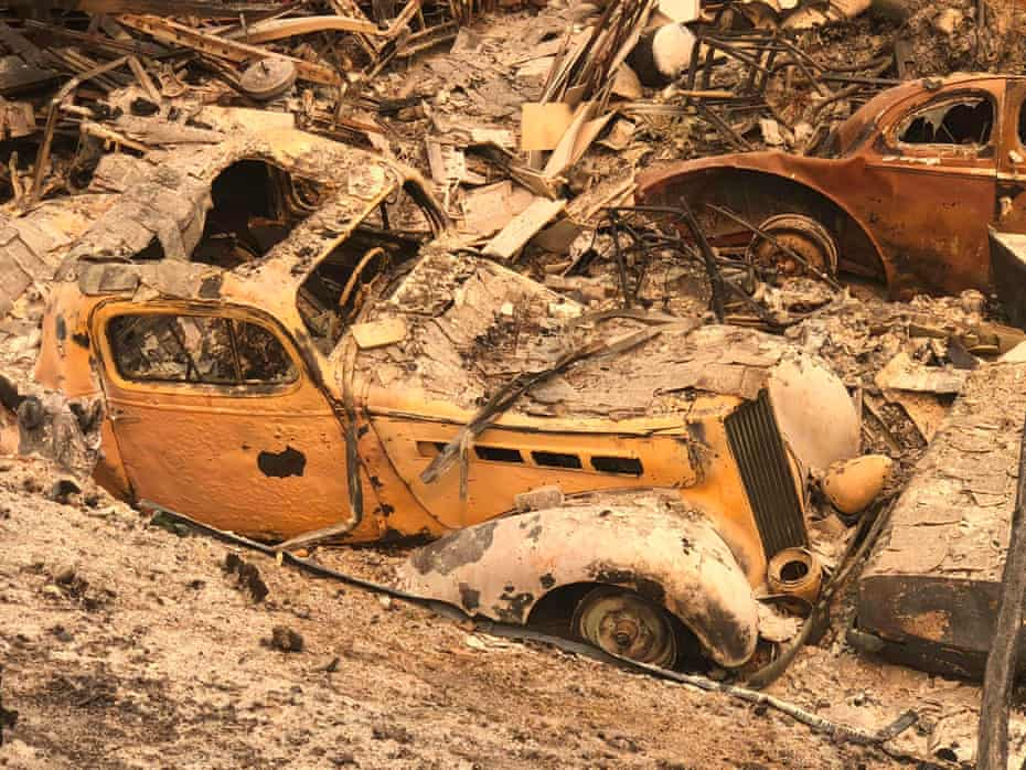 An antique car, part of a collection, lies in rubble near Redding.