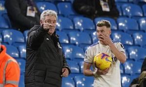 Steve Bruce exchanges words with Leeds' Ezgjan Alioski during Newcastle's 5-2 loss at Elland Road.
