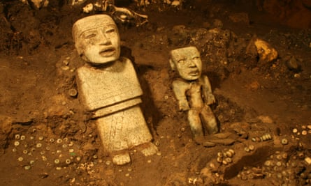 The two standing statues discovered in the tunnel.
