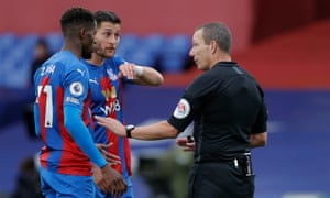 Referee Kevin Friend explains his decision after awarding a penalty for Joel Ward's handball.