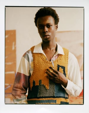 Hand printed shirt and recycled hand knitted sweater vest by Bethany Williams