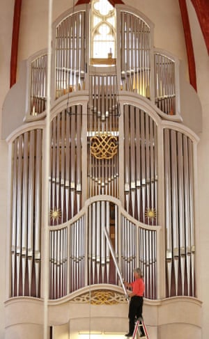 One of the 4267 pipes of the organ at St Thomas Church in Leipzig, Germany, where JS Bach was cantor, being taken out for cleaning.