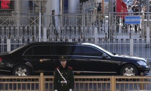 A Mercedes limousine believed to carrying North Korean leader Kim Jong-un leaves a train station in Beijing.
