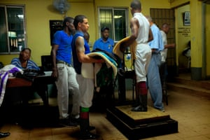 Dick Cardenas from Panama, who is a former champion jockey in Jamaica, weighs in