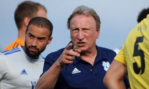 Neil Warnock makes a forceful point to his Cardiff City players during a pre-season friendly against Bodmin Town.