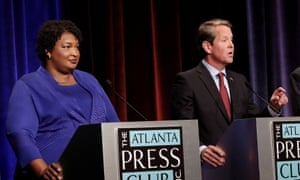 Stacey Abrams with Brian Kemp before the 2018 midterms. In the gubernatorial election, Abrams accused Kemp of voter suppression.