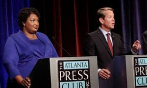 Stacey Abrams and Brian Kemp at a debate in Atlanta, Georgia, in October.
