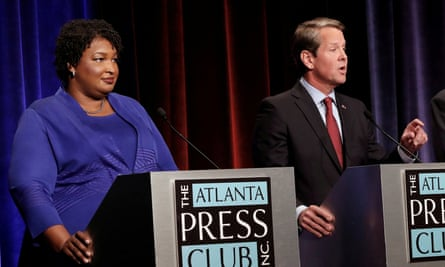Stacey Abrams and Brian Kemp at a debate in Atlanta, Georgia, on 23 October 2018.