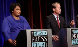 Stacey Abrams at a debate with Brian Kemp in October. Abrams said of Kemp: 'You don't deserve a promotion when you do not serve the people you've been hired to serve.'