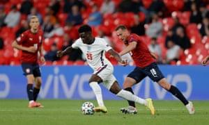 Bukayo Saka of England surges past Jan Boril of the Czech Republic.