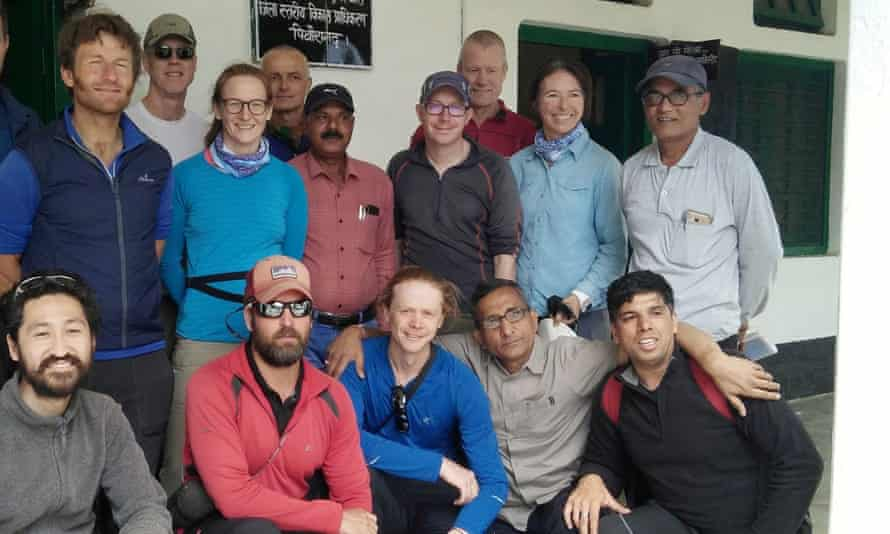 Climbers pose for a photo before leaving for their expedition in Munsiyari. Australian woman Ruth McCance is second from the right in the back row