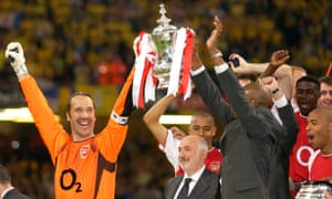 David Seaman lifts the FA Cup after Arsenal beat Southampton in the 2003 final.