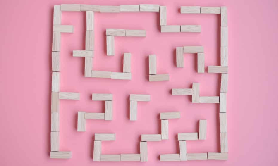 maze of wooden blocks on a pink background