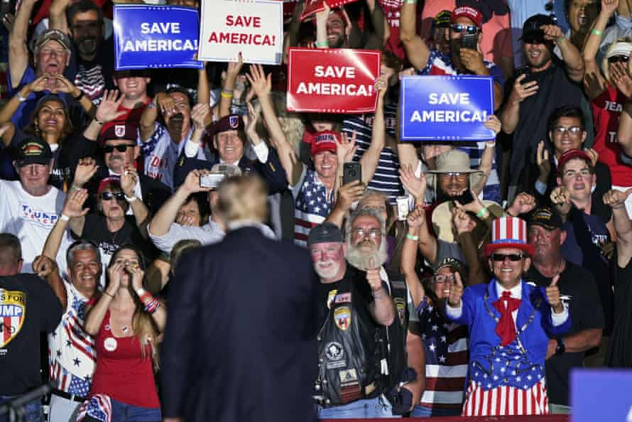 Supporters cheer former president Donald Trump during a rally in Wellington, Ohio.