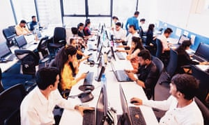 A busy call centre. The return to work and school has seen Zoom shares plummet.