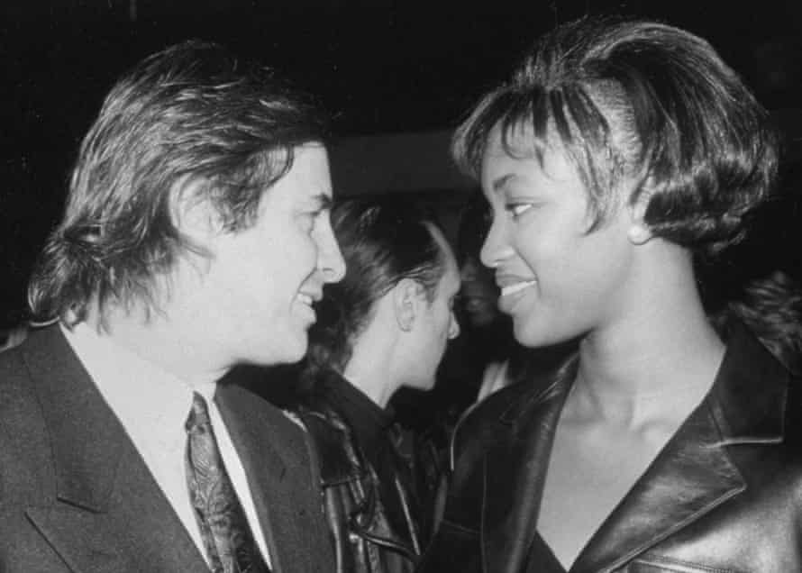 Elite modeling agency founder John Casablancas w. model Naomi Campbell at the Red Zone night club in 1990