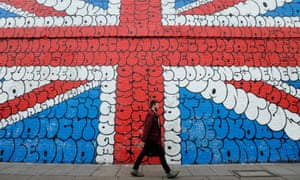 A giant graffiti mural depicting the Union Jack in London.