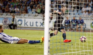 Real Madrid's Gareth Bale, right, scores the team's third goal in Sunday evening's 3-0 opener against Real Sociedad.