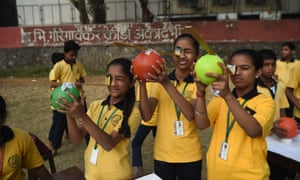 School students use DIY solar eclipse viewing equipment to view a rare 'ring of fire' solar eclipse at a school in Mumbai