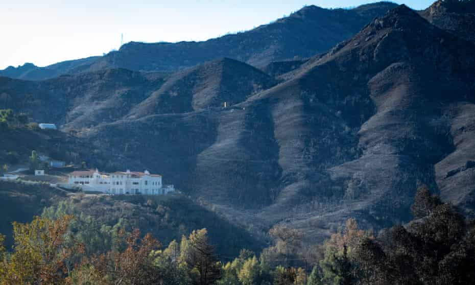 A saved mansion on a burned hillside near Cornell.