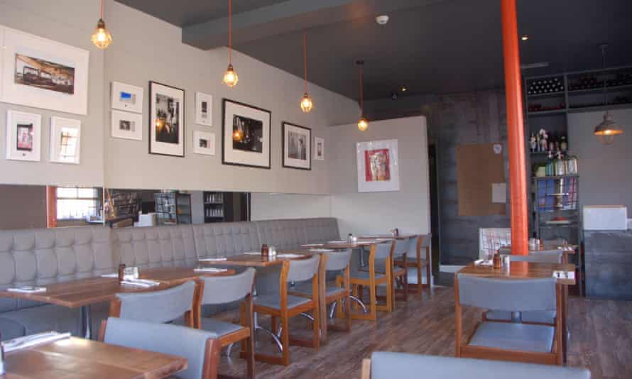 Prints and photos adorn the walls of the Wuff bistro, in Dublin's Stoneybatter neighbourhood