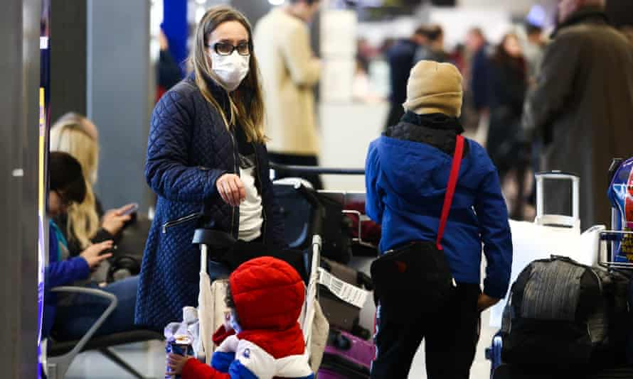 A woman wears a protective mask at Krakow airport in Poland.