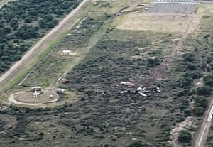 The wreckage of the plane in the field.