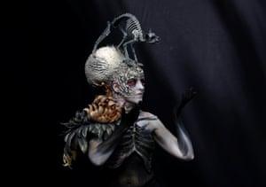 A skeletal cat adorns this contestants head dress