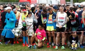 Runners keep warm before the start