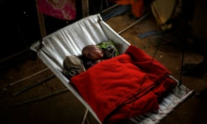 A baby girl sleeps inside a temporary shelter at the Balukhali refugee camp near Cox's Bazar in Bangladesh