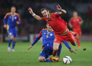 Andorra's Ildefons Lima takes out Bale.