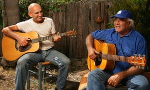 Singer-songwriters Paul Kelly and Kev Carmody in Kelly's backyard