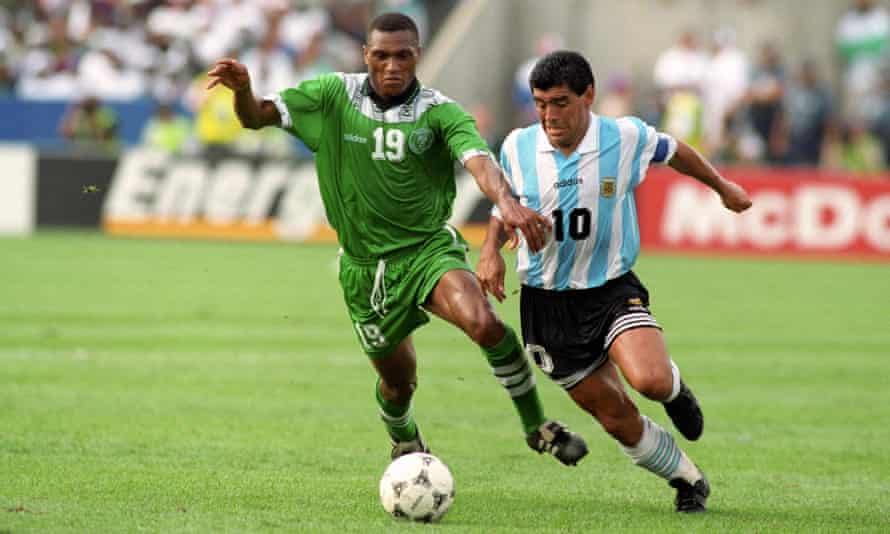 Nigeria's Michael Emenalo tussles with Argentina's Diego Maradona at the 1994 World Cup.