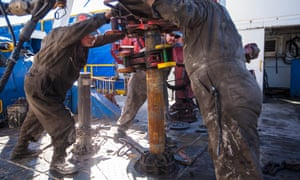 Workers drilling into the Marcellus shale.