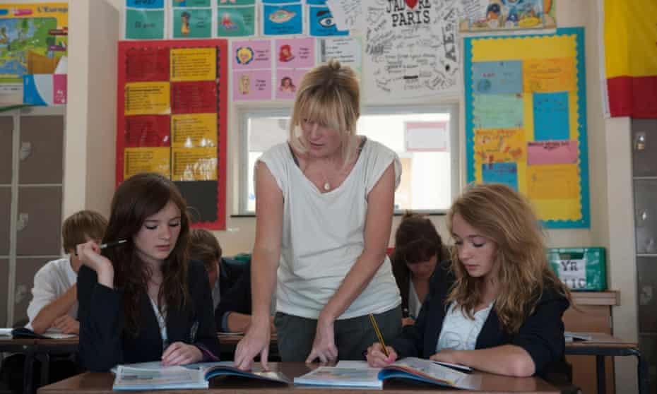 Female teacher in a class of teenagers