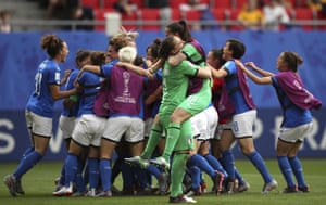 Italy celebrate their 2-1 win over Australia.