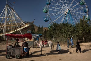 Amusement park rides at Qargha Lake, a popular weekend destination on the outskirts of the city.