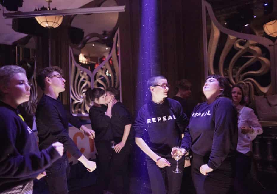 Women dance in repeal jumpers